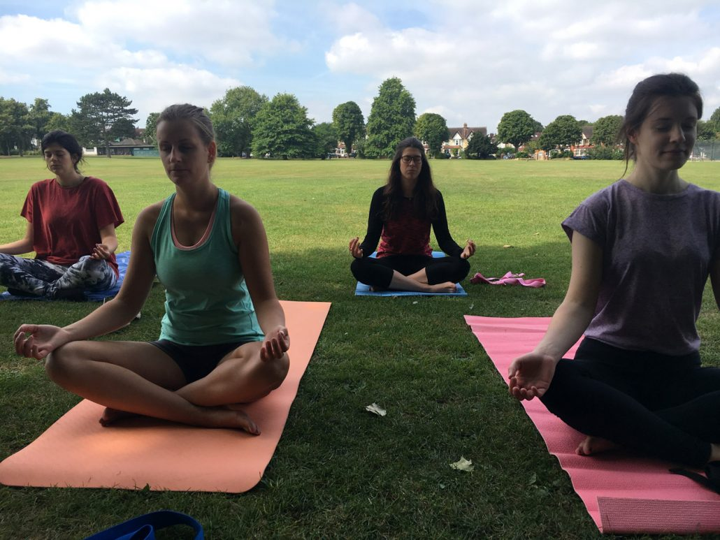 Solis Yoga students practising Lotus Padmasana